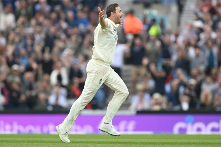 Success: England's Ollie Robinson celebrates taking the wicket of India's Cheteshwar Pujara in the fourth Test at the Oval (AFP/DANIEL LEAL-OLIVAS)