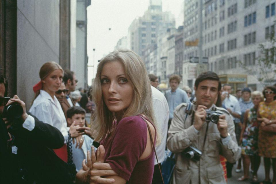 "<p>While living in New York City with Polanski in 1967, Tate <a href=""https://www.esquire.com/entertainment/g1504/sharon-tate-photos/"" rel=""nofollow noopener"" target=""_blank"" data-ylk=""slk:posed for Esquire in photos"" class=""link rapid-noclick-resp"">posed for <em>Esquire</em> in photos</a> that would become highly publicized and regarded in pop culture. </p>"