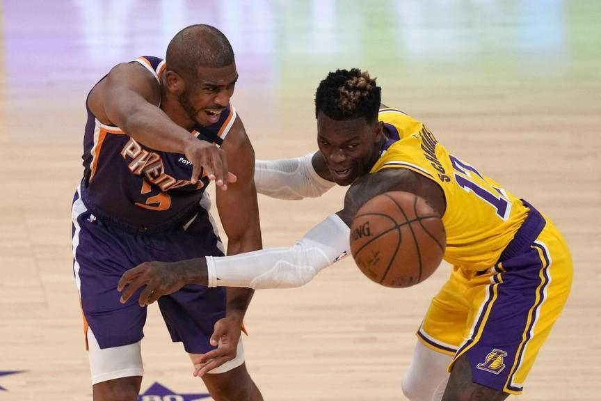 Chris Paul being guarded by Dennis Schroder in 2021 round one