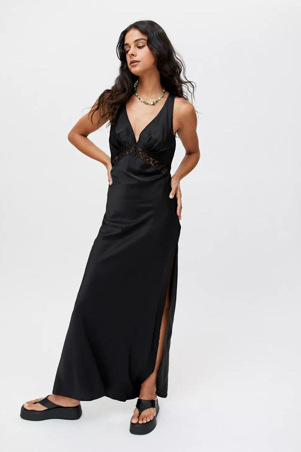 """If you have to wear black, we highly suggest this under-$100 Urban Outfitters find, which works for formal weddings and elegant garden weddings alike. $79, Urban Outfitters. <a href=""""https://www.urbanoutfitters.com/shop/lioness-dakota-satin-maxi-slip-dress"""" rel=""""nofollow noopener"""" target=""""_blank"""" data-ylk=""""slk:Get it now!"""" class=""""link rapid-noclick-resp"""">Get it now!</a>"""