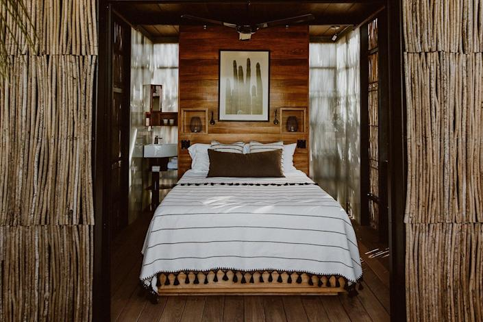 A treehouse bedroom at Acre Baja