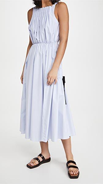 """<p><strong>Jason Wu</strong></p><p>shopbop.com</p><p><strong>$550.00</strong></p><p><a href=""""https://go.redirectingat.com?id=74968X1596630&url=https%3A%2F%2Fwww.shopbop.com%2Fpleated-dress-tie-detail-jason%2Fvp%2Fv%3D1%2F1529159323.htm&sref=https%3A%2F%2Fwww.townandcountrymag.com%2Fstyle%2Fg35967684%2Fwhat-to-wear-to-get-vaccinated%2F"""" rel=""""nofollow noopener"""" target=""""_blank"""" data-ylk=""""slk:Shop Now"""" class=""""link rapid-noclick-resp"""">Shop Now</a></p><p>Channel classic Audrey Hepburn with a pleated boatneck dress. All you need are some accessories and your look will be complete. </p>"""