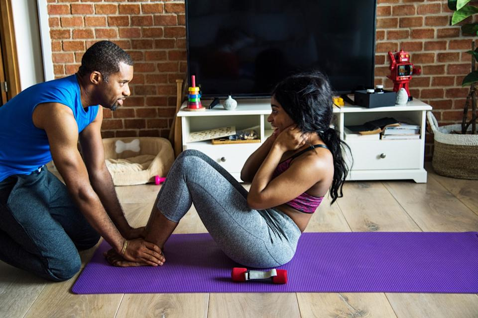 Couple exercising together at home during the pandemic