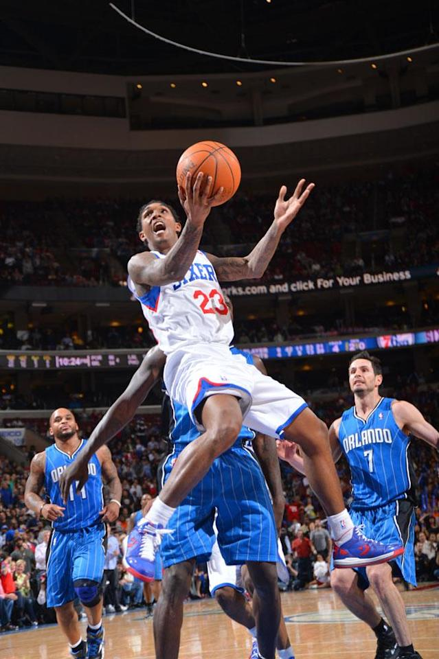 PHILADELPHIA, PA - APRIL 7: Louis Williams #23 of the Philadelphia 76ers goes to the basket against the Orlando Magic on April 7, 2012 at the Wells Fargo Center in Philadelphia, Pennsylvania. NOTE TO USER: User expressly acknowledges and agrees that, by downloading and/or using this Photograph, user is consenting to the terms and conditions of the Getty Images License Agreement. Mandatory Copyright Notice: Copyright 2012 NBAE