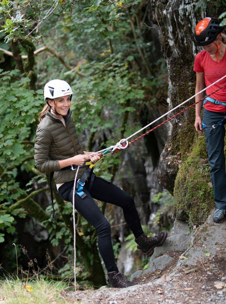 <p>Earlier in the day, Kate wore an olive puffer instead of the blazer, as she rock-climbed with the Royal Air Force Air Cadets. She paired the outfit with the most stylish accessory—a safety helmet. </p>