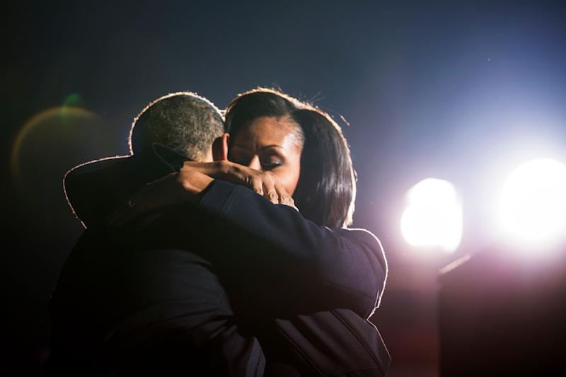 President Barack Obama hugs first lady Michelle Obama at a campaign rally in Des Moines, Iowa.