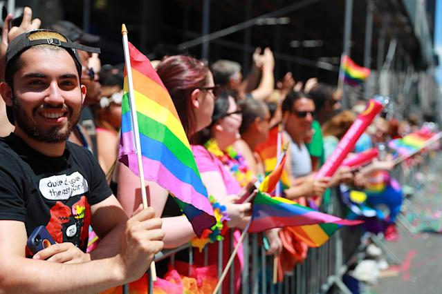 <p>People cheer and wave rainbow flags during the N.Y.C. Pride Parade in New York on June 25, 2017. (Photo: Gordon Donovan/Yahoo News) </p>