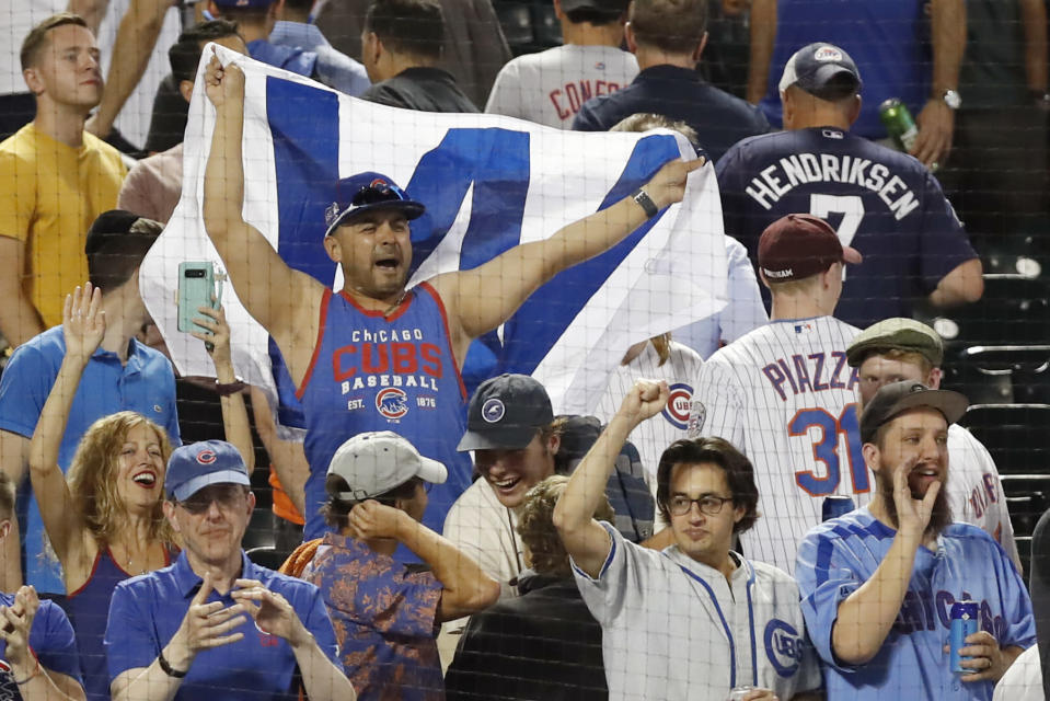 Chicago Cubs' fans celebrate the team's three baseball game sweep of the New York Mets, Thursday, Aug. 29, 2019, in New York. (AP Photo/Kathy Willens)