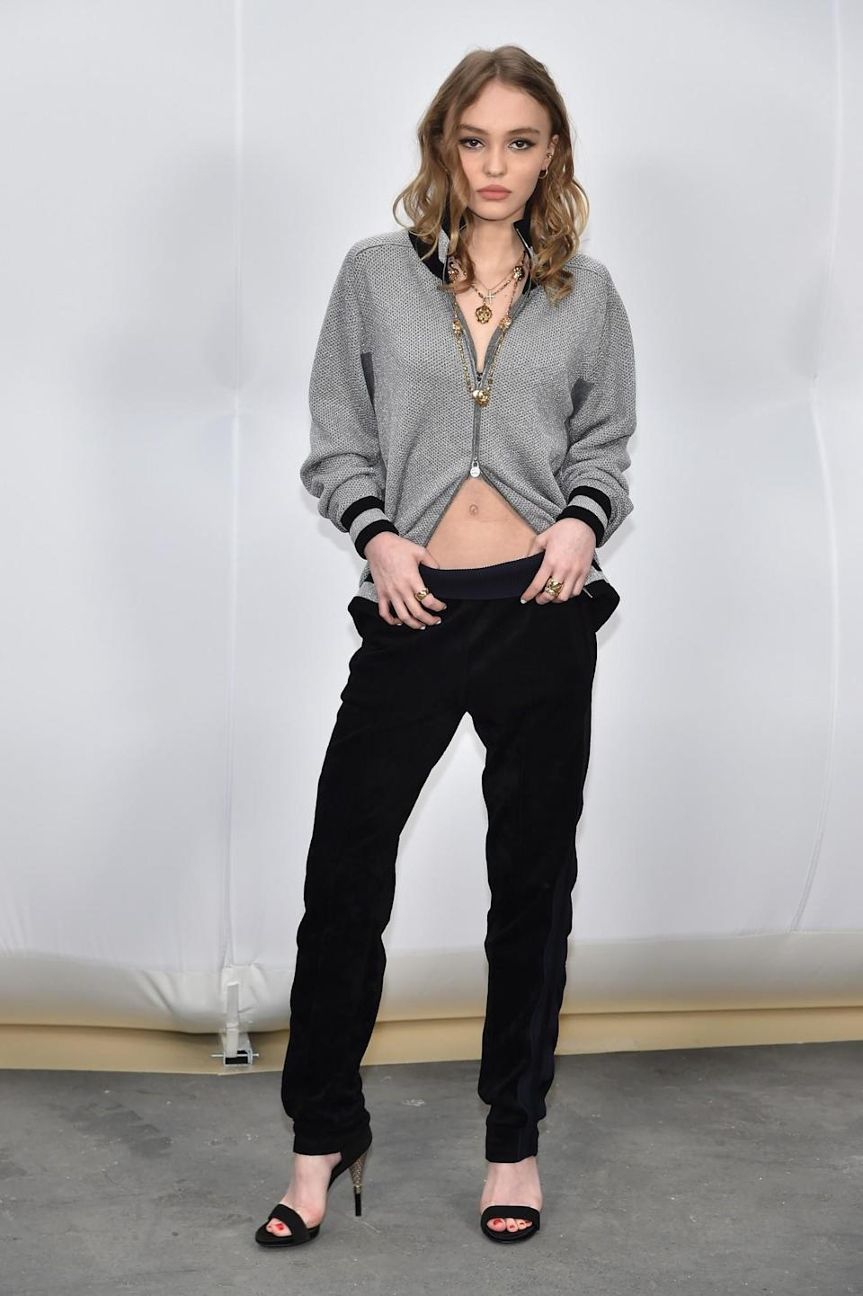 <p>Lily-Rose Depp turned up wearing a zipped-up cardigan. <i>[Photo: Getty]</i> </p>