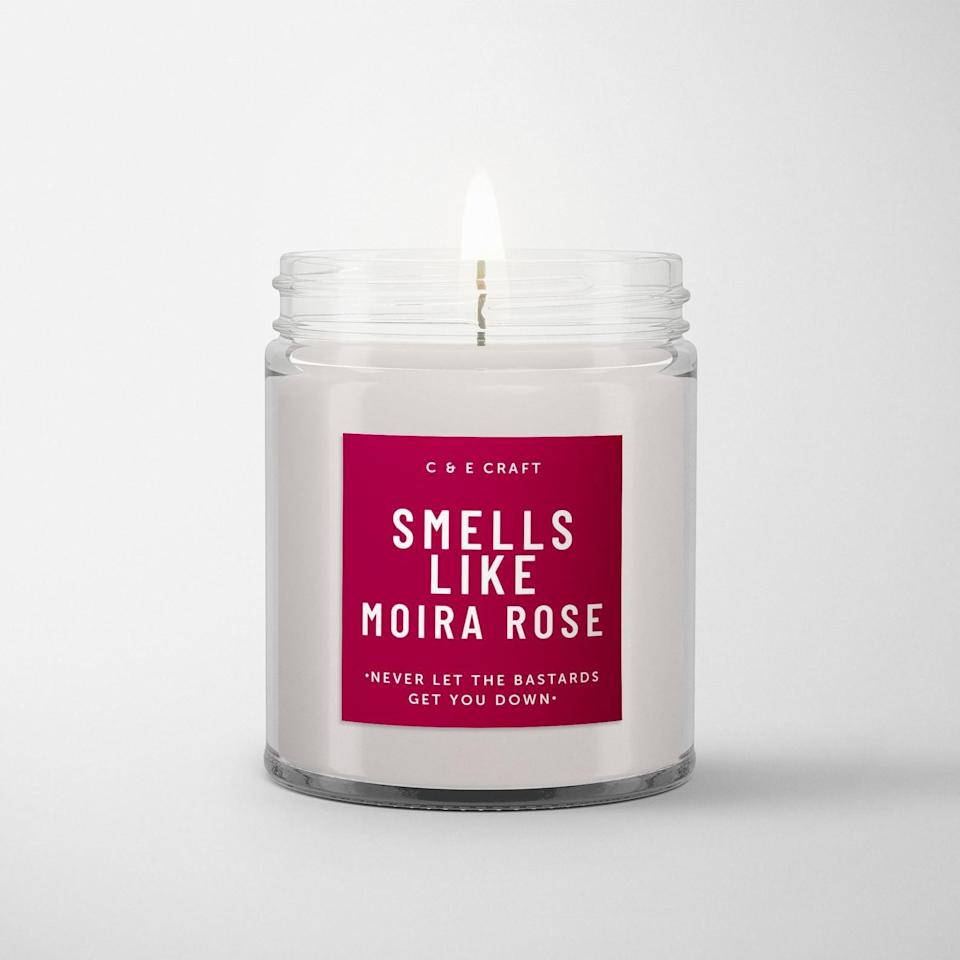 """<p>The <span>""""Smells Like Moira Rose"""" Candle</span> ($17) comes in three distinct scents, mandarins/lemon, amber/pink lotus, and sandalwood/vanilla, depending on the Moira you feel like gifting. </p>"""