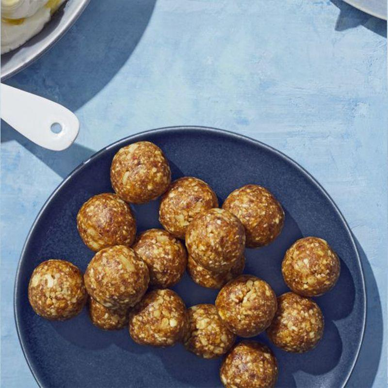 """<p>Whip up a big batch of these energy balls that your kids can eat on the way home from school or before sports practice.</p><p><em><a href=""""https://www.womansday.com/food-recipes/a32688860/apple-energy-balls-recipe/"""" rel=""""nofollow noopener"""" target=""""_blank"""" data-ylk=""""slk:Get the Apple Energy Balls recipe."""" class=""""link rapid-noclick-resp"""">Get the Apple Energy Balls recipe. </a></em></p>"""