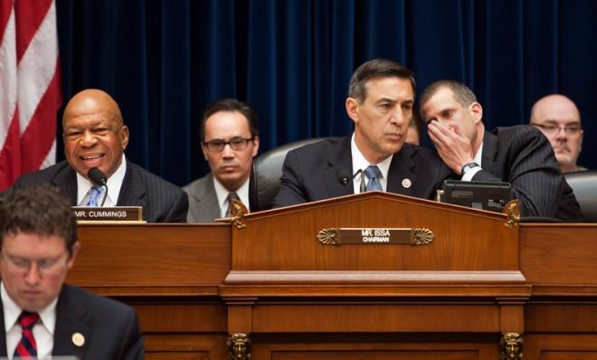 GOP Rep. Darrell Issa (center) confers with a congressional lawyer during the hearing on Benghazi, May 8.
