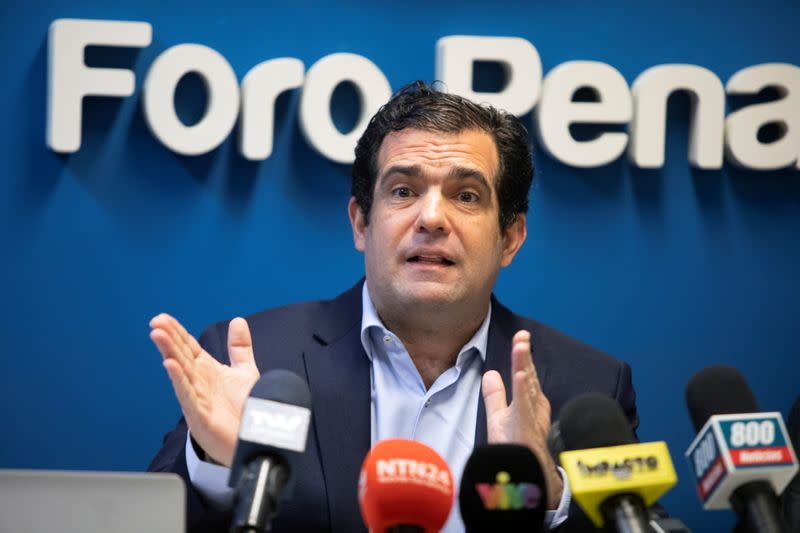 Alfredo Romero, director of rights group Penal Forum addresses the media, in Caracas