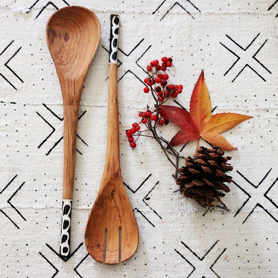 """<p>xnasozistudio.com</p><p><strong>$50.00</strong></p><p><a href=""""https://www.xnasozistudio.com/product/salad-servers-olivewood-and-bone-inlay-black-design"""" rel=""""nofollow noopener"""" target=""""_blank"""" data-ylk=""""slk:Shop Now"""" class=""""link rapid-noclick-resp"""">Shop Now</a></p><p>Founded by <a href=""""https://www.housebeautiful.com/lifestyle/a30201457/home-buyer-grant-nasozi-kakembo/"""" rel=""""nofollow noopener"""" target=""""_blank"""" data-ylk=""""slk:Nasozi Kakembo"""" class=""""link rapid-noclick-resp"""">Nasozi Kakembo </a>in 2011, xN Studio offers an assortment of home decor inspired and sourced from around the world. All of the company's items are either made in Brooklyn, Washington, D.C., or through fair-trade partnerships in Uganda. </p>"""