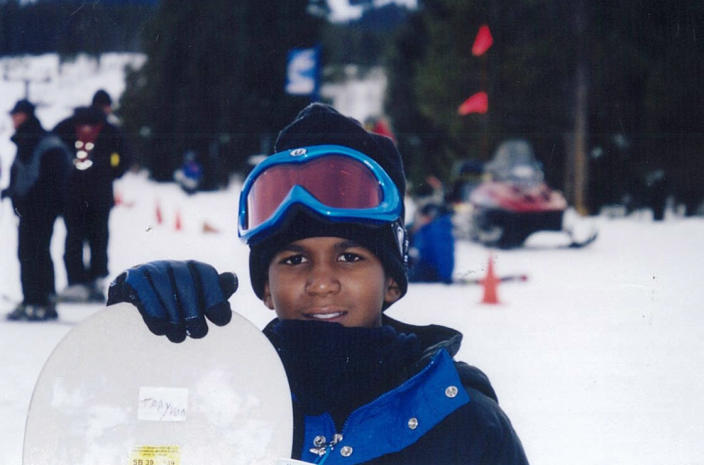 FILE - This undated file photo provided by the Martin family, shows Trayvon Martin snowboarding. Martin was slain in the town of Sanford, Fla., on Feb. 26 in a shooting that has set off a nationwide furor over race and justice. Neighborhood crime-watch captain George Zimmerman claimed self-defense and has not been arrested, though state and federal authorities are still investigating. When he was shot, Martin was not the pint-sized baby-faced boy in photos that have been on front pages around the country. And Zimmerman wasn't the hulking figure in the mugshot that has been making the newspapers. These photos are several years old, yet they may well have shaped public perceptions of the shooting. (AP Photo/Martin Family, File)