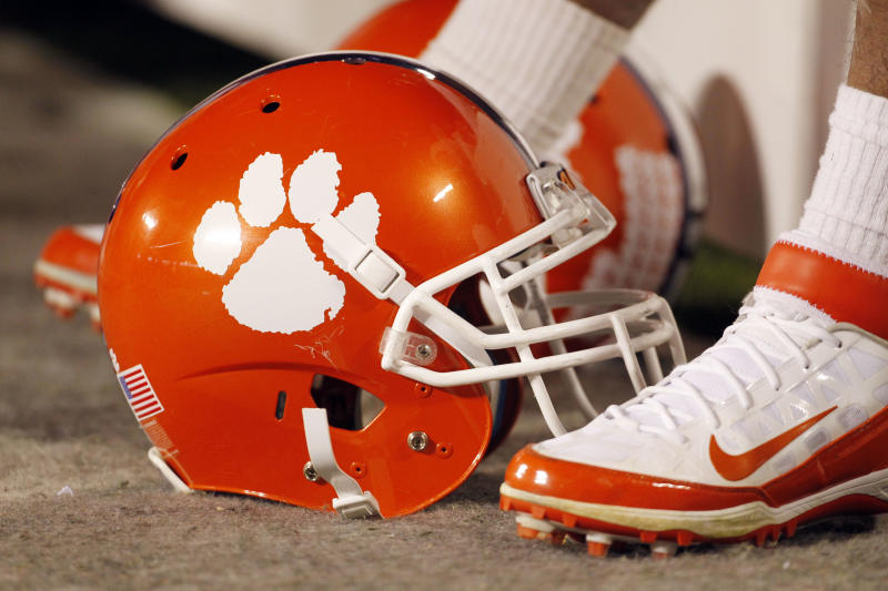 FILE - In this Dec. 3, 2011, file photo, a Clemson football helmet rests on the sidelines during the second half of an NCAA college football game against Virginia Tech in Charlotte, N.C. John Antonio, the man who designed Clemson's tiger paw logo, died Thursday, May 30, 2013, in Greenville, S.C., after a long battle with cancer, the university said. He was 83. (AP Photo/Bob Leverone, File)