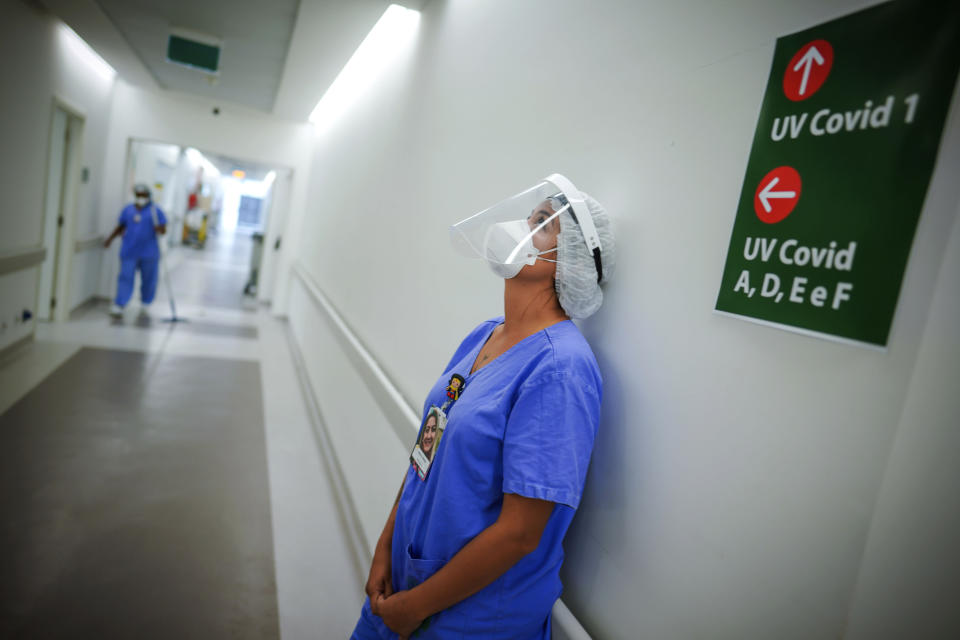 FILE - In this March 19, 2021 file photo, a healthcare worker lends against a wall in the corridor of an ICU unit for COVID-19 patients at the Hospital das Clinicas, in Porto Alegre, Brazil. The number of Brazilian states with ICU capacity above 90% has slipped from 17 months ago, according to data from the state-run Fiocruz medical research institute. (AP Photo/Jefferson Bernardes, File)