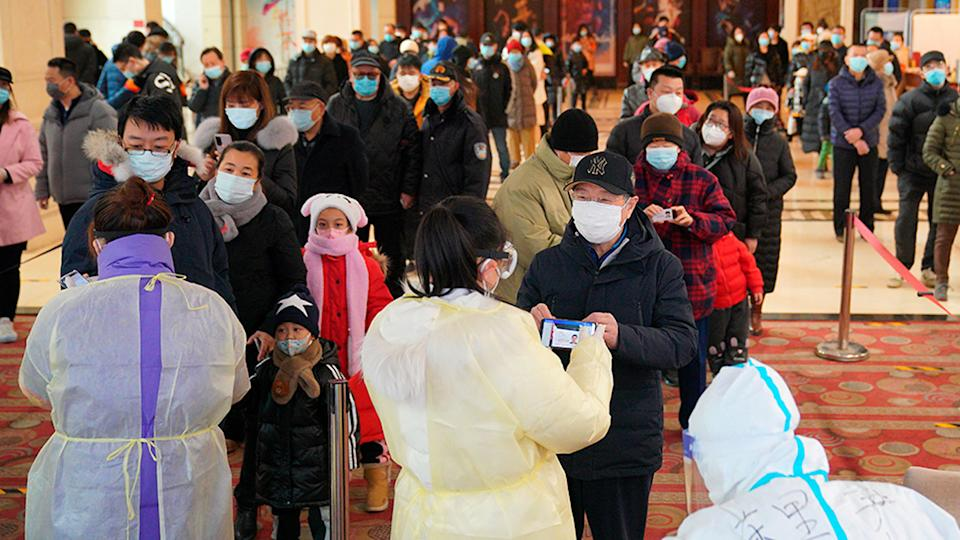 Residents line up to register for coronavirus tests in Shijiazhuang in northern China's Hebei Province, Monday, January 12, 2021. Source: AP
