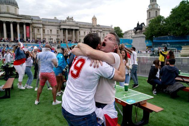 England fans celebrate as Shaw scores. (Photo: Andrew Matthews - PA Images via Getty Images)