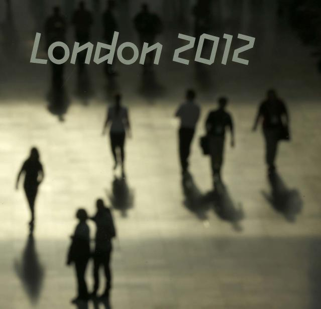 People walk through the ExCel Centre, home of several Olympic events, during the 2012 Summer Olympics, Wednesday, Aug. 1, 2012, in London. (AP Photo/Charlie Riedel)