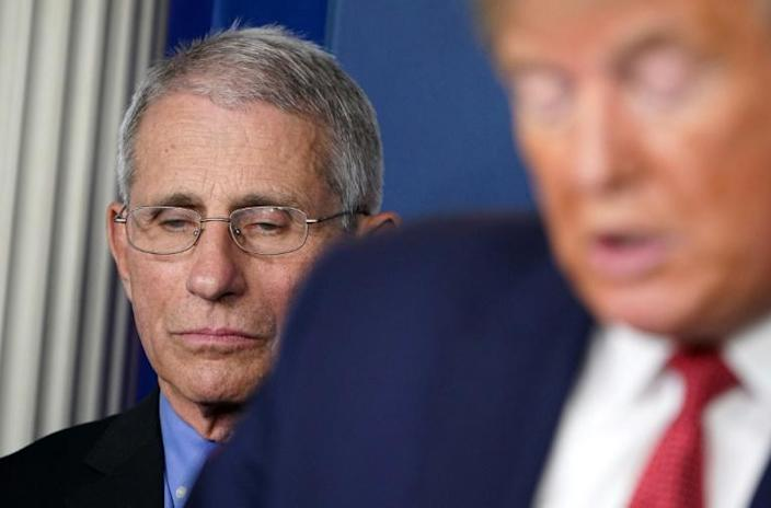"""The small studies carried out so far amount to """"anecdotal"""" evidence, said Anthony Fauci, head of infectious diseases at the US National Institutes of Health - here with President Donald Trump (AFP Photo/MANDEL NGAN)"""