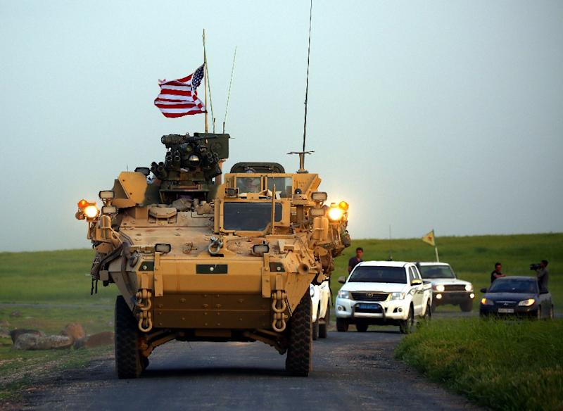 Erdogan's warning came after US President Donald Trump decided to pull out American troops from Syria (AFP Photo/DELIL SOULEIMAN)