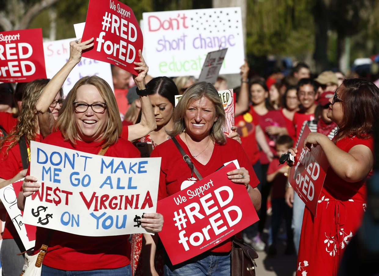 Teachers and advocates for public education march at the Arizona Capitol. (Photo: Ross D. Franklin/AP)