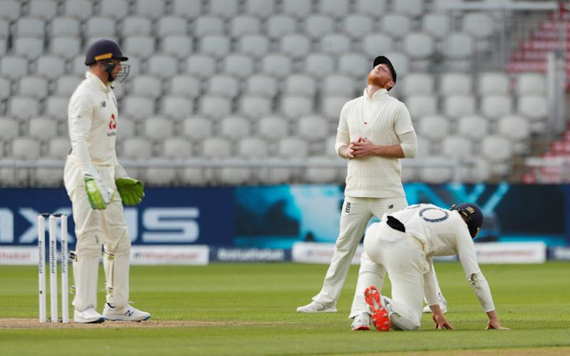 England's Ben Stokes reacts after Jos Buttler missed a catch - REUTERS