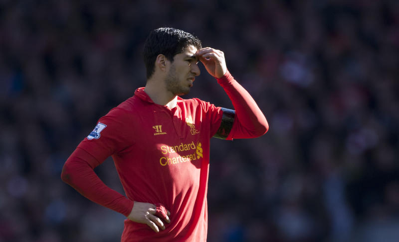 Liverpool's Luis Suarez is seen during his team's 2-2 draw against Chelsea in their English Premier League soccer match at Anfield Stadium, Liverpool, England, Sunday April 21, 2013. Suarez appeared to bite the arm of Chelsea's Branislav Ivanovic at the end of a tussle during the game. (AP Photo/Jon Super)