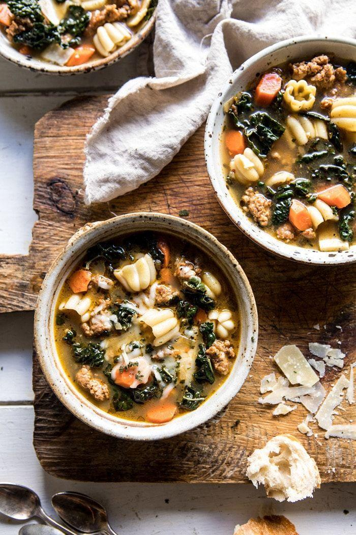 "<p>We can't imagine a more perfect weeknight meal for September, October, or November. This warming soup features a basil pesto broth, carrots, kale, lemon, and all the noodles you could ask for. A sprinkle of cheese and crusty bread finishes things off beautifully. </p><p><strong>Get the recipe at <a href=""https://www.halfbakedharvest.com/spicy-italian-pesto-noodle-soup/"" rel=""nofollow noopener"" target=""_blank"" data-ylk=""slk:Half Baked Harvest"" class=""link rapid-noclick-resp"">Half Baked Harvest</a>.</strong></p><p><a class=""link rapid-noclick-resp"" href=""https://www.amazon.com/Cook-Home-02418-Stainless-Stockpot/dp/B00Z4TSE32/?tag=syn-yahoo-20&ascsubtag=%5Bartid%7C10050.g.3569%5Bsrc%7Cyahoo-us"" rel=""nofollow noopener"" target=""_blank"" data-ylk=""slk:SHOP SOUP POTS"">SHOP SOUP POTS</a></p>"