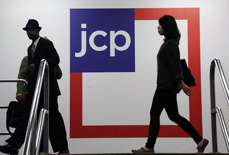 In this  Tuesday, April 9, 2013, photo, Customers shop at a J.C. Penney store, in New York. Americans cut back on spending in April after their income failed to grow, a sign economic growth may be slowing, according to data released by the Commerce Department, Friday, May 31, 2013. (AP Photo/Mark Lennihan)