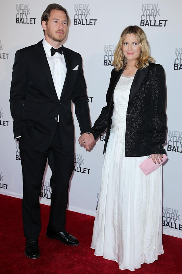 "FILE - This May 10, 2012 file photo shows Will Kopelman, left, and Drew Barrymore attending the New York City Ballet's 2012 Spring Gala performance in New York. The couple welcomed a baby girl named Olive Barrymore Kopelman on Sept. 26. A statement from Chris Miller at Barrymore's production company Flower Films said the baby was born ""happy, healthy and welcomed by the whole family."" It did not provide specifics on the birth. (AP Photo/Starpix, Amanda Schwab, file)"