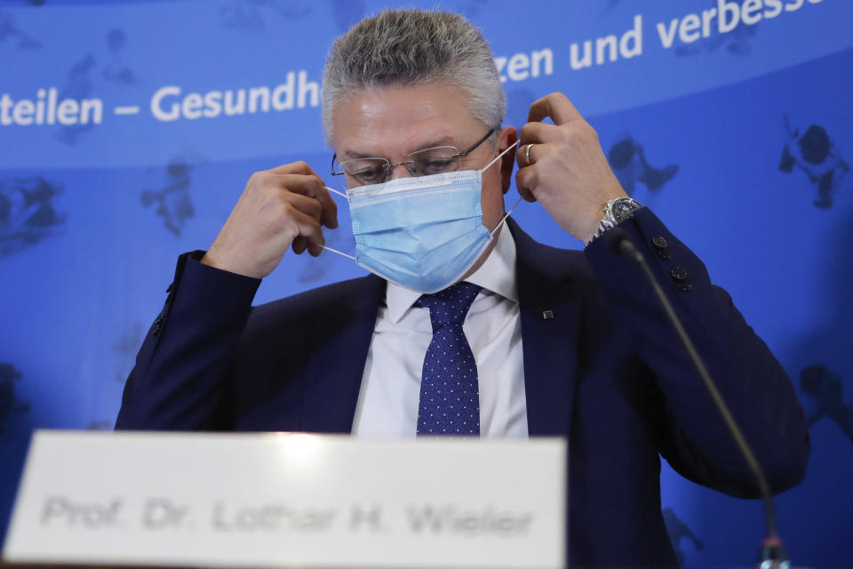 The head of the Robert Koch Institute, Germany's federal government agency and research institute responsible for disease control and prevention, Lothar Wieler, arrives for a news conference on the coronavirus and the COVID-19 disease in Berlin, Thursday, Oct. 22, 2020. Germany's disease control center is reporting a new daily record increase in coronavirus infections, which rocketed past the 10,000 mark for the first time as the pandemic continues to spread. (AP Photo/Markus Schreiber, Pool)