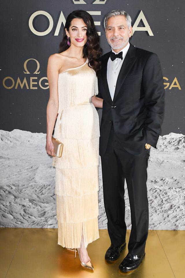 A trip to the '20s, anyone? Amal wore a cream fringe custom Armani dress that had her looking like the pinnacle of glamour. George wore a tuxedo by the same designer.