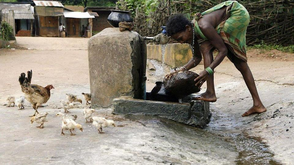 An Indian woman washes her utensils in Kanjeriguda village, Orissa state, India during an outbreak of diarrheal diseases in 2007