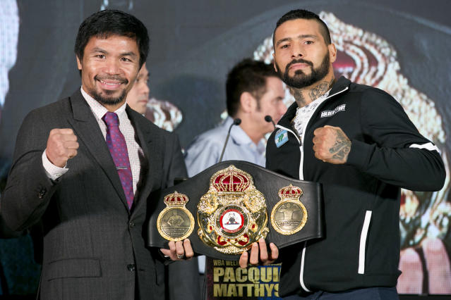 Manny Pacquiao, left, poses with Argentine WBA welterweight champion Lucas Matthysse on Thursday. (AP)