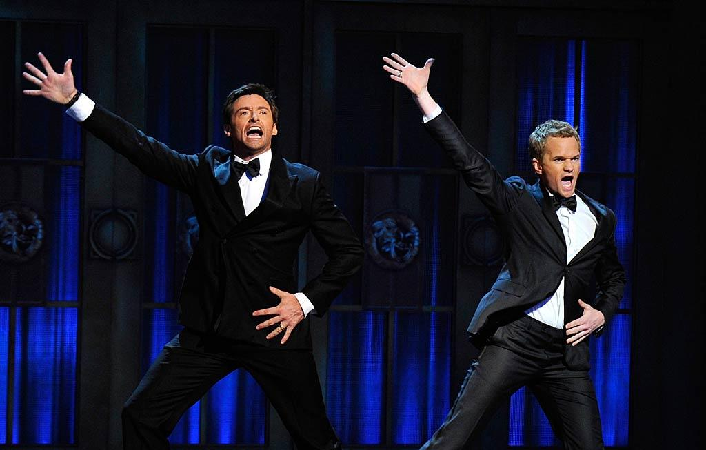 "Neil Patrick Harris -- who took on master of ceremonies duties at the Tony Awards for the second year in a row -- got a little help from previous host Hugh Jackman during a song-and-dance number. Which emcee do you like better? Andrew H. Walker/<a href=""http://www.gettyimages.com/"" target=""new"">GettyImages.com</a> - June 12, 2011"