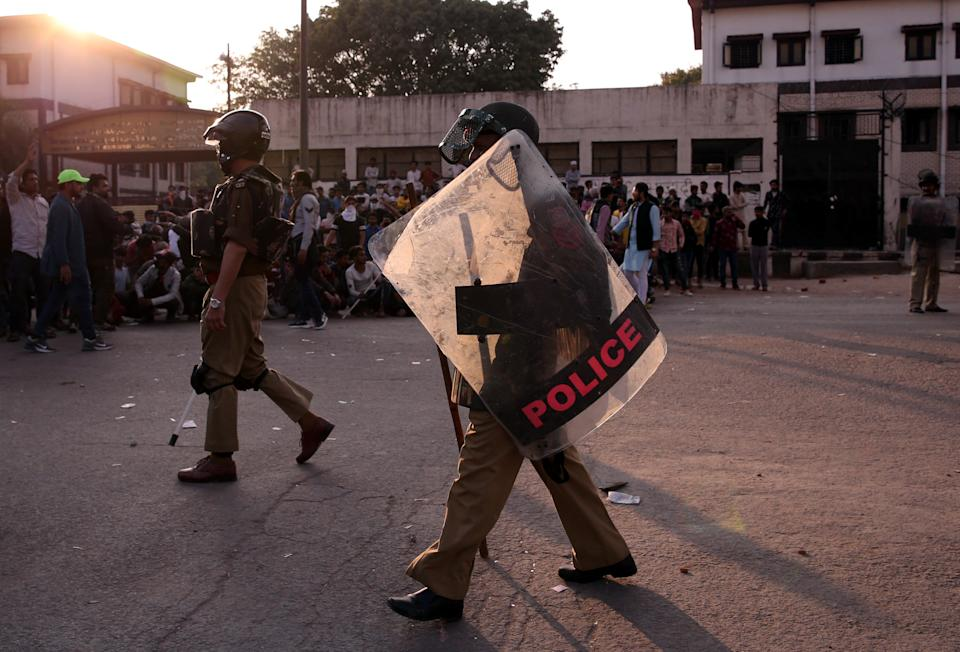 Policemen patrol in a riot affected area after clashes erupted between people demonstrating for and against a new citizenship law in New Delhi, India, February 25, 2020. REUTERS/Danish Siddiqui