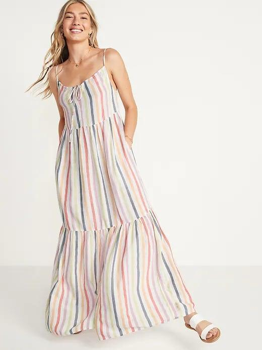 <p>We love most any pocketed dress, but we especially love this breezy <span>Old Navy Tiered Maxi Swing Sundress</span> ($45) for summertime.</p>