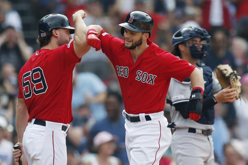 Boston Red Sox's Andrew Benintendi celebrates his solo home run with Sam Travis (59) as New York Yankees' Kyle Higashioka, right, looks away, during the second inning of a baseball game in Boston, Saturday, July 27, 2019. (AP Photo/Michael Dwyer)