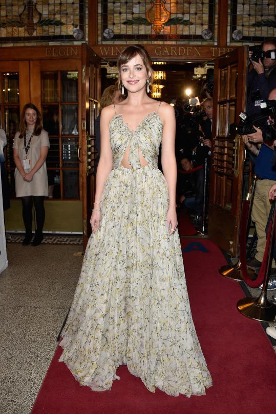 "<p>If there was any doubt after Sarah Burton made Kate Middleton's wedding dress that the current designer at Alexander McQueen has a much lighter touch than the brand's namesake, look no further than the flowy gown on Dakota Johnson. At the ""Black Mass"" premiere at the 2015 Toronto International Film Festival, the actress wore a floral gown with appliqué details and tasteful cutouts from the Resort 2016 collection.</p>"