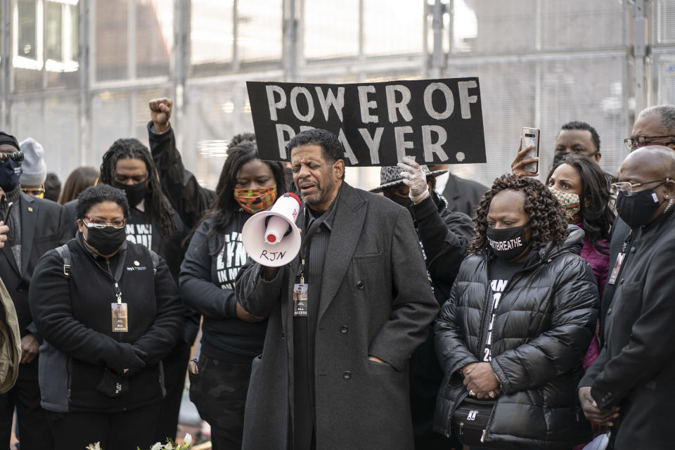 Bishop Richard D Howell of Shiloh Temple leads a prayer on the plaza of the Hennepin County Government Center Sunday, March 7, 2021, in Minneapolis, Minn. (Jerry Holt /Star Tribune via AP)