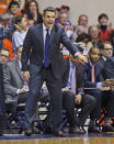 Virginia coach Tony Bennett makes a point to his team during the first half of an NCAA college basketball game against James Madison in Harrisonburg, Va., Friday, Nov. 14, 2014. (AP Photo/Steve Helber)