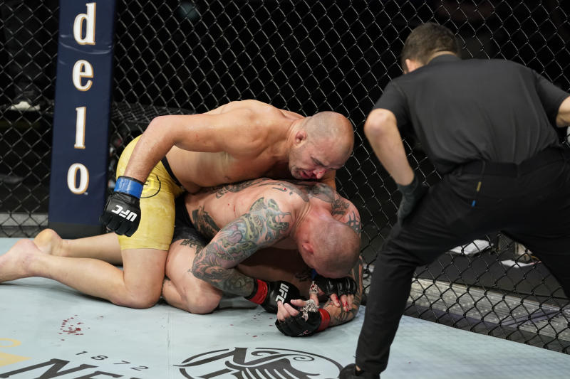 (L-R) Glover Teixeira of Brazil punches Anthony Smith in their light heavyweight bout during the UFC Fight Night Event at VyStar Veterans Memorial Arena on May 13, 2020 in Jacksonville, Florida. (Photo by Cooper Neill/Zuffa LLC via Getty Images)