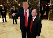 U.S. President-elect Donald Trump and Softbank CEO Masayoshi Son speak to the press after meeting at Trump Tower in Manhattan, New York City, U.S., December 6, 2016. REUTERS/Brendan McDermid