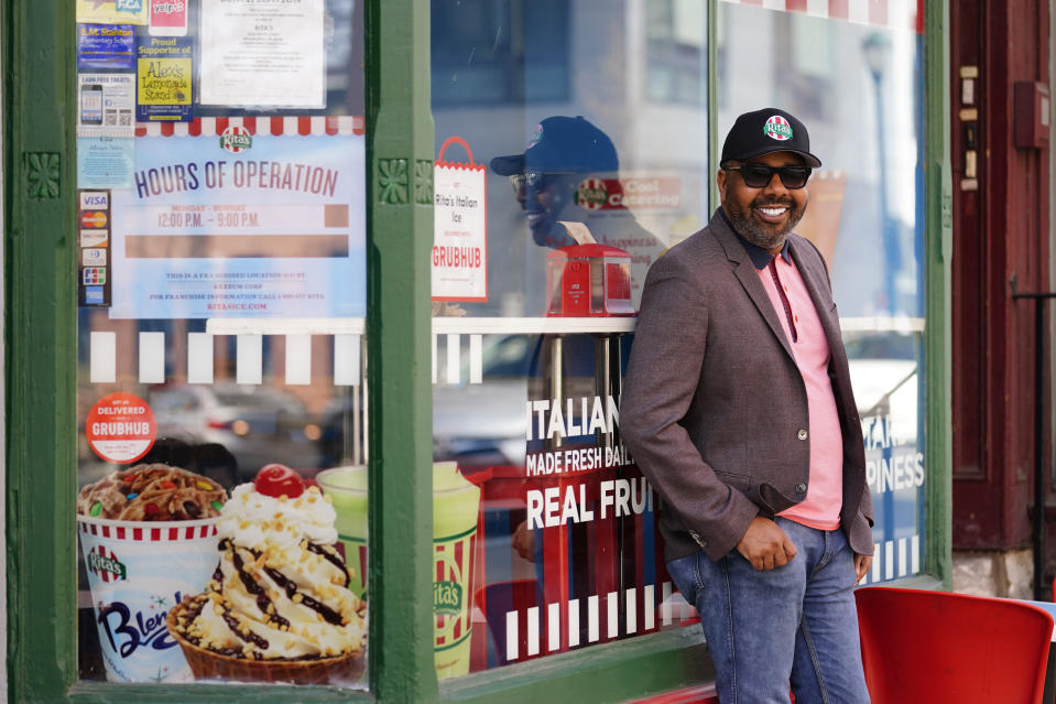 Business owner Aaron Anderson who operators multiple restaurants poses for a photograph at his Rita's Italian Ice location in Philadelphia, Friday, March 26, 2021. Restaurants and delivery companies remain uneasy partners, haggling over fees and struggling to make the service profitable for themselves and each other. Anderson thinks delivery fees are too high. But he also sees some value in delivery companies, which can help restaurants test new concepts. (AP Photo/Matt Rourke)