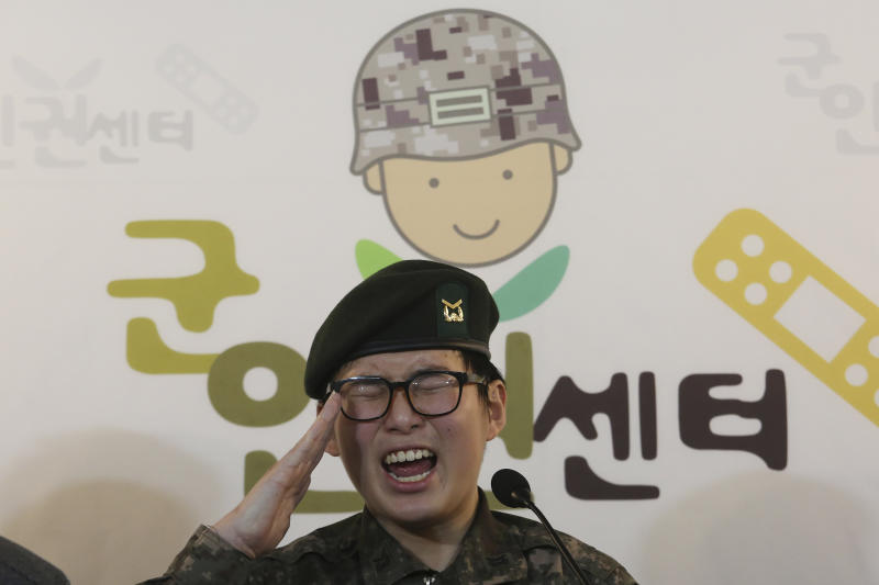 "South Korean army Sergeant Byun Hui-su salutes during a press conference at the Center for Military Human Right Korea in Seoul, South Korea, Wednesday, Jan. 22, 2020. South Korea's military decided Wednesday to discharge Byun who recently undertook gender reassignment surgery, a ruling expected to draw strong criticism from human rights groups.The sign reads ""The Center for Military Human Right Korea."" (AP Photo/Ahn Young-joon)"