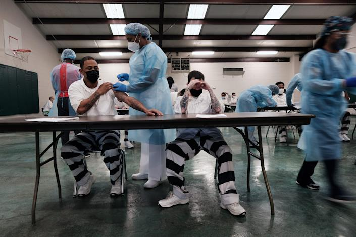Prisoners at the Bolivar County Correctional Facility in Cleveland, Miss., receive a COVID-19 vaccination administered by medical workers with Delta Health Center on April 28. The prisoners, part of a population particularly vulnerable to COVID-19, are given a choice between the one-shot Johnson & Johnson vaccine and one from Moderna.