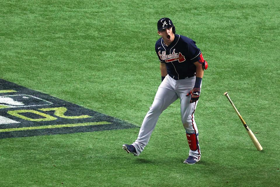ARLINGTON, TEXAS - OCTOBER 12: Austin Riley #27 of the Atlanta Braves celebrates a solo home run against the Los Angeles Dodgers during the ninth inning in Game One of the National League Championship Series at Globe Life Field on October 12, 2020 in Arlington, Texas. (Photo by Ron Jenkins/Getty Images)