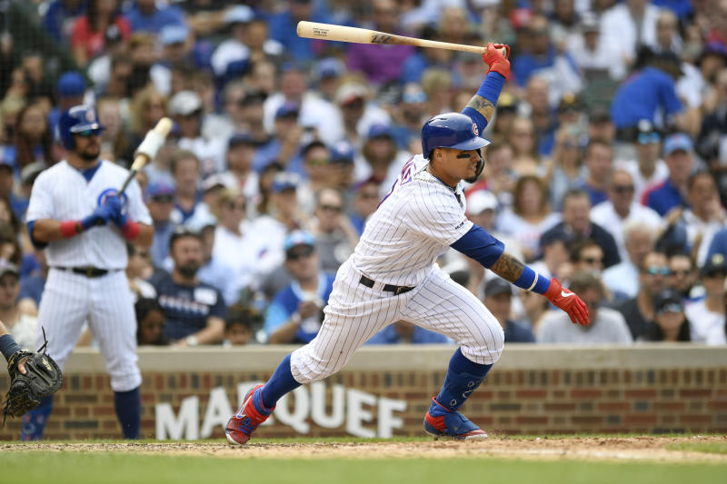 Chicago Cubs' Javier Baez hits a single during the sixth inning of a baseball game against the Milwaukee Brewers, Saturday, Aug 31, 2019, in Chicago. Milwaukee won 2-0. (AP Photo/Paul Beaty)
